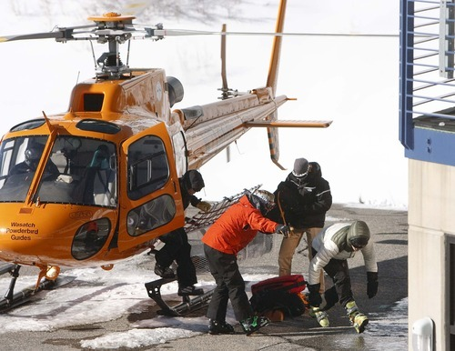 Leah Hogsten  |  The Salt Lake Tribune Friends of the 25-year-old male who died in an avalanche are led away from the Wasatch Powderbird helicopter that brought all three and their rescuers out of the canyon. One person died in an avalanche in the backcountry between Big and Little Cottonwood canyons late Saturday, January 28, 2012.  A group of three people were skiing on Kessler Ridge, an area that drops down into Mineral Fork Canyon in Big Cottonwood Canyon, when the avalanche was triggered at about 11:30 a.m. Wasatch Backcountry Rescue and several other crews searched the area with dogs and were able to eventually locate the victim. Hoyal said the skier was found dead at the scene at about 12:45 p.m.