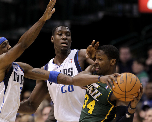 Dallas Mavericks' Jason Terry (31) and Ian Mahinmi, center, of France, defend against a pass by Utah Jazz's C.J. Miles (34) in the first half of an NBA basketball game on Friday, Jan. 27, 2012, in Dallas. (AP Photo/Tony Gutierrez)
