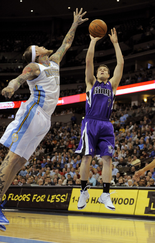 Sacramento Kings guard Jimmer Fredette (7) shoots over Denver Nuggets center Chris Andersen (11) during the second quarter of an NBA basketball game Wednesday, Jan. 4, 2012, in Denver. (AP Photo/Jack Dempsey)