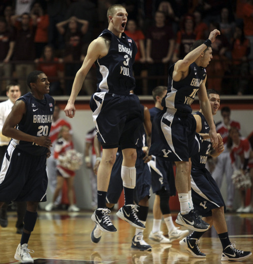 BYU players celebrate at midcourt after defeating Virginia Tech 70-68 in an NCAA college basketball game in Blacksburg, Va., Wednesday, Jan. 25 2012. (AP Photo/The Roanoke Times, Matt Gentry)
