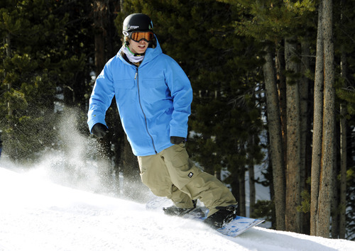 Snowboarder Kevin Pearce hits the slopes for the first time, Tuesday, Dec. 13, 2011, in Breckenridge, Colo. Nearly two years after an accident on the halfpipe that nearly took his life, Pearce is doing what nobody could have predicted by riding again. (AP Photo/Jack Dempsey)