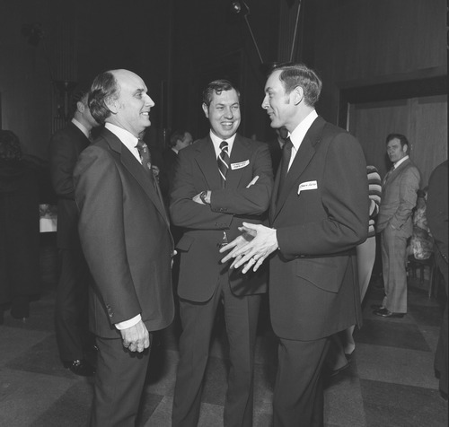 Courtesy of U.S. Senate Historical Office Sen. Orrin Hatch chats with fellow freshman Rep. Dan Marriott, R-Utah, and Sen. Jake Garn, R-Utah, at a reception for freshmen members of Congress.