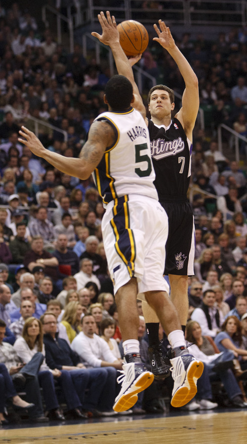 Trent Nelson  |  The Salt Lake Tribune Sacramento's Jimmer Fredette shoots the ball in the first half, with Utah Jazz guard Devin Harris (5) defending, Saturday at the EnergySolutions Arena in Salt Lake City. The Jazz downed the Kings, 96-93.
