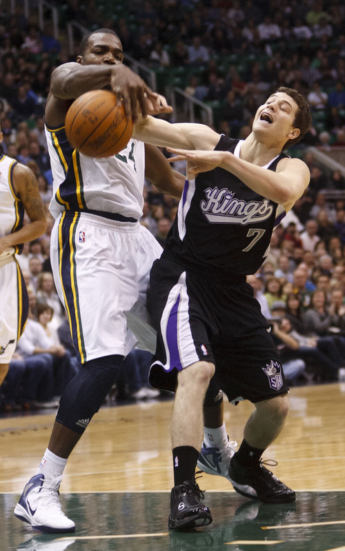 Trent Nelson  |  The Salt Lake Tribune Utah Jazz forward Paul Millsap (24) knocks the ball away from Sacramento's Jimmer Fredette in the first half of game Saturday at the EnergySolutions Arena in Salt Lake City. The Jazz downed the Kings, 96-93.