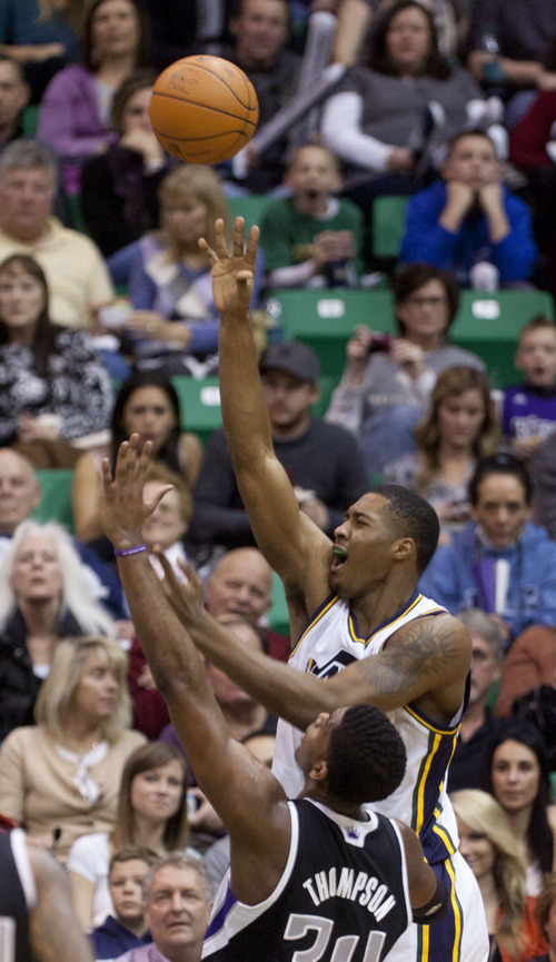 Trent Nelson  |  The Salt Lake Tribune Utah Jazz forward Derrick Favors (15) shoots the ball in the second half Saturday at the EnergySolutions Arena in Salt Lake City. The Jazz downed the Sacramento Kings, 96-93.