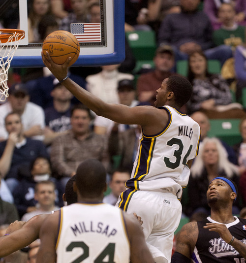 Trent Nelson  |  The Salt Lake Tribune Utah Jazz guard/forward C.J. Miles (34) leaps to the basket in the second half during game Saturday against Sacramento at the EnergySolutions Arena in Salt Lake City. The Jazz downed the Kings, 96-93.