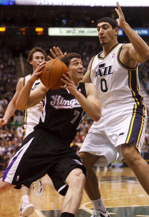Trent Nelson  |  The Salt Lake Tribune Sacramento's Jimmer Fredette drives on Utah Jazz center Enes Kanter (0) in the second half Saturday at the EnergySolutions Arena in Salt Lake City. The Jazz downed the Kings, 96-93.