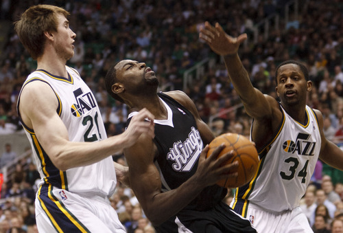 Trent Nelson  |  The Salt Lake Tribune Utah Jazz guard/forward C.J. Miles (34) swats the ball away from Sacramento's Tyreke Evans in the second half Saturday at the EnergySolutions Arena in Salt Lake City. The Jazz downed the Kings, 96-93.