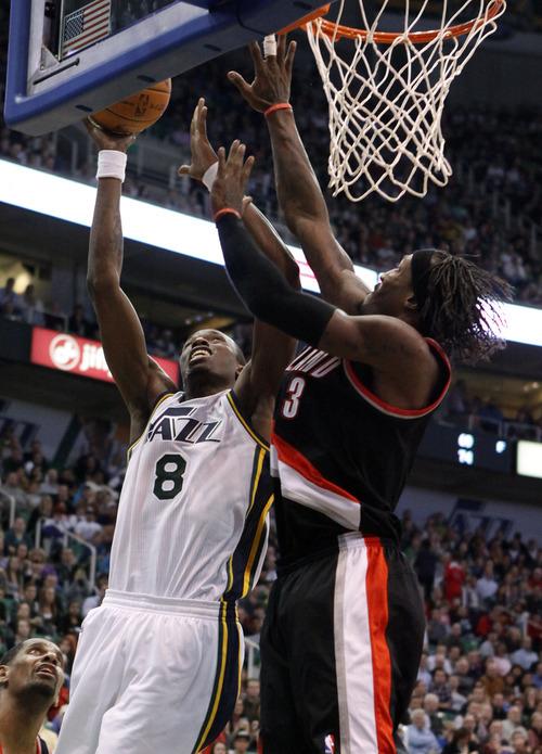 Utah Jazz forward Josh Howard (8) goes for a shot against Portland Trail Blazers forward Gerald Wallace (3) during the second half of an NBA basketball game Monday, Jan. 30, 2012, in Salt Lake City. The Utah Jazz won 93-89. (AP Photo/Jim Urquhart)