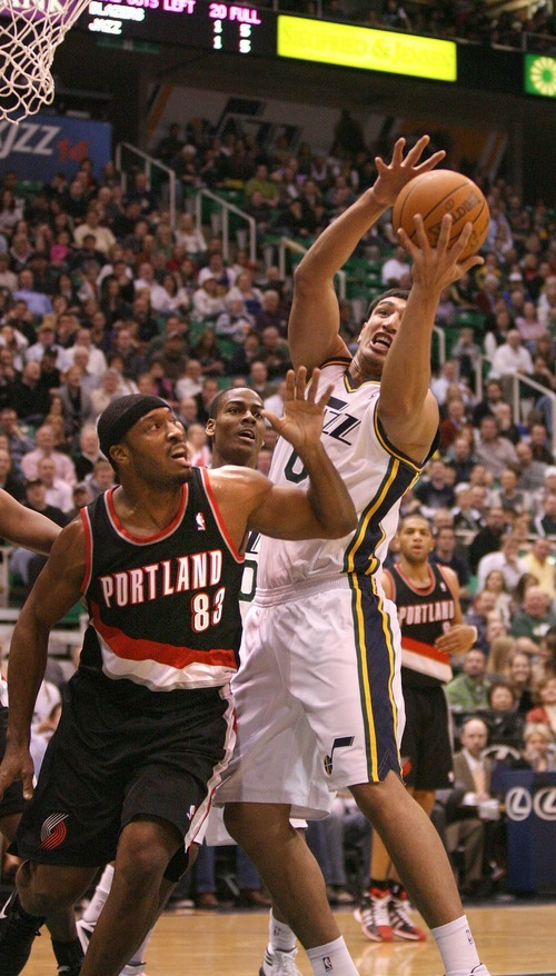 Paul Fraughton | The Salt Lake Tribune. Utah's Enes Kanter battles  Portland's Craig Smith for the rebound. The Utah Jazz played Portland at Energy Solutions Arena.  Monday, January 30, 2012