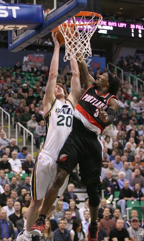 Paul Fraughton | The Salt Lake Tribune. Gordon Hayward's shot is  blocked by Gerald Wallace of the Trail Blazers The Utah Jazz played Portland at Energy Solutions Arena.  Monday, January 30, 2012