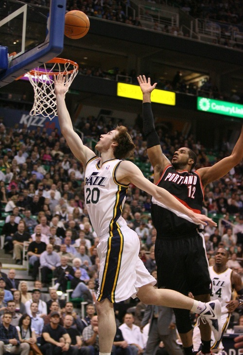 Paul Fraughton | The Salt Lake Tribune. Gordon Hayward flies  to the basket, missing the shot that was followed up by  Derrick Favors for the score. The Utah Jazz played Portland at Energy Solutions Arena.  Monday, January 30, 2012