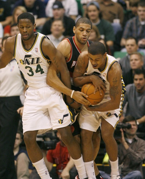 Paul Fraughton | The Salt Lake Tribune. C.J. Miles and Earl Watson  fight Portland's Nicolas Batum for the ball.  The Utah Jazz played Portland at Energy Solutions Arena.  Monday, January 30, 2012