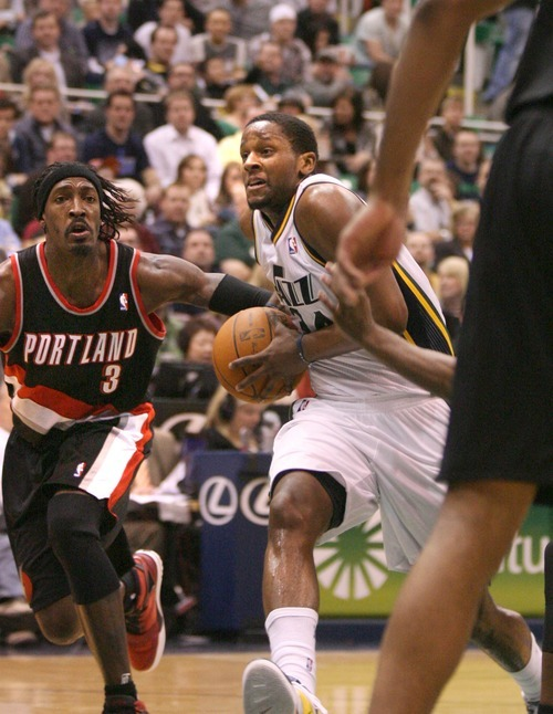Paul Fraughton | The Salt Lake Tribune. C.J. Miles drives past Portland's Gerald Wallace on his way to the basket. The Utah Jazz played Portland at Energy Solutions Arena.  Monday, January 30, 2012