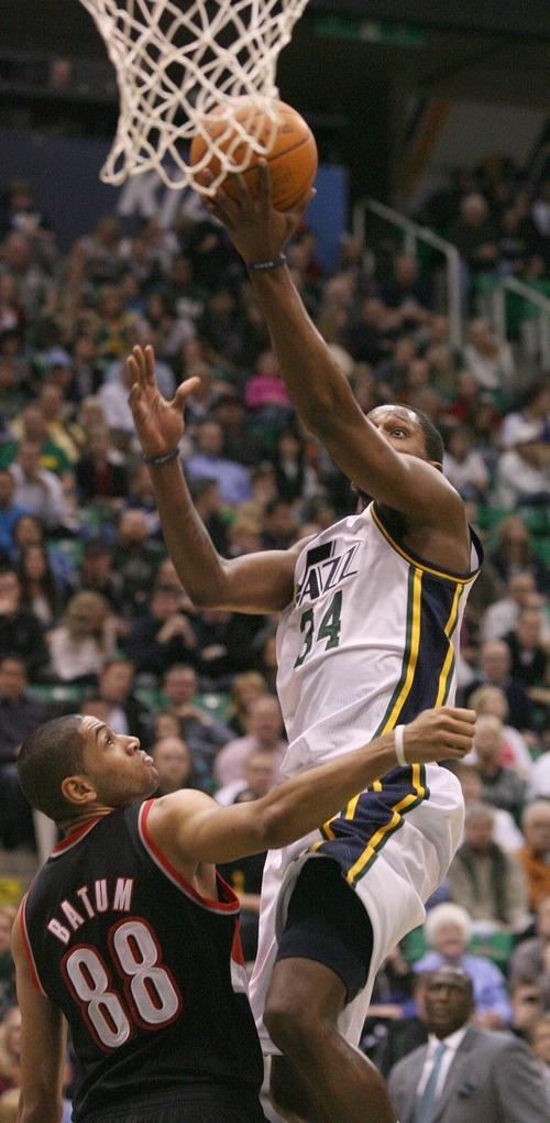 Paul Fraughton | The Salt Lake Tribune. C.J. Miles drives to the basket as  Portland's Nicolas Batum defends. The Utah Jazz played Portland at Energy Solutions Arena.  Monday, January 30, 2012