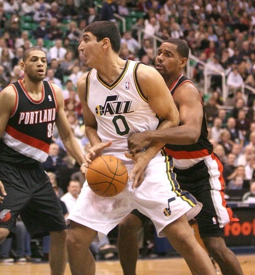 Paul Fraughton | The Salt Lake Tribune. Utah Jazz center Enes Kanter is fouled by Portland's Kurt Thomas. The Utah Jazz played Portland at Energy Solutions Arena.  Monday, January 30, 2012
