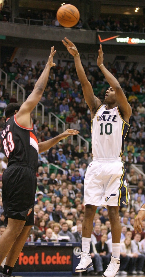 Paul Fraughton | The Salt Lake Tribune. Alec Burks shoots the jump shot over Portland's Craig Smith. The Utah Jazz played Portland at Energy Solutions Arena.  Monday, January 30, 2012