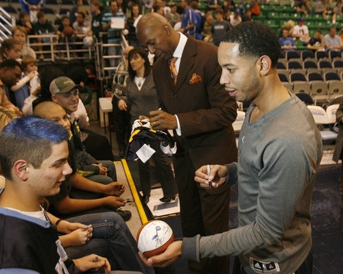 Paul Fraughton | The Salt Lake Tribune. Devin Harris and Thurl Baily sign autographs before the game.The Utah Jazz played Portland at Energy Solutions Arena.  Monday, January 30, 2012