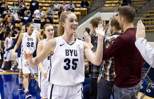 Jaren Wilkey | Photo courtesy of BYU  Senior Kristen Riley high-fives fans after the Cougars' victory over Pepperdine earlier this month.