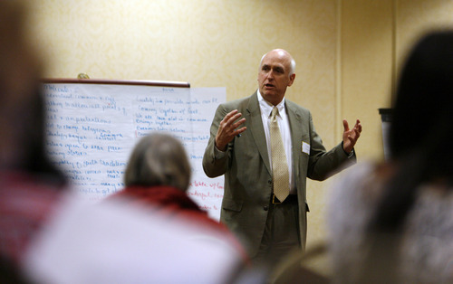 Francisco Kjolseth  |  The Salt Lake Tribune John Kesler with Utah Civility and Community leads a gathering of interfaith leaders as they discuss