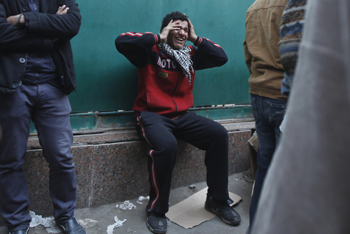 An Egyptian man reacts after hearing about the death of his relative killed during clashes at a soccer stadium, outside a morgue in Cairo, Egypt, Thursday, Feb. 2, 2012. Scores of Egyptian soccer fans were crushed to death Wednesday, Feb. 1, 2012, while others were fatally stabbed or suffocated after being trapped in a long narrow corridor trying to flee rival fans armed with knives, clubs and stones, in the country's worst ever soccer violence that killed at least 74 people, witnesses and health officials said Thursday. (AP Photo/Khalil Hamra)