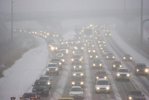 Paul Fraughton  |  The Salt Lake Tribune   Traffic on I-15 slows to a crawl as a snowstorm hits the Salt Lake City area  on  Wednesday, Dec. 29, 2010.