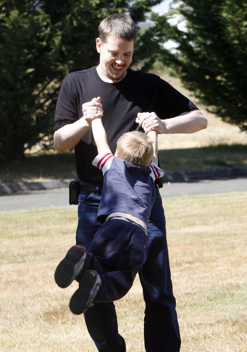 Rick Egan   |  The Salt Lake Tribune  Joshua Powell plays with his son Braden, in a park near his home, in Puyallup, Washington,  Friday, August 19, 2011