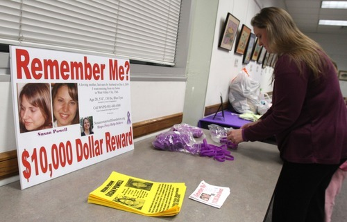 Rick Egan  | The Salt Lake Tribune file photo  Jennifer Graves sets up a table Monday for people to leave donations. Friends and family of missing West Valley City woman Susan Cox Powell gathered donations for the Christmas Box House, at the Hunter Library in West Valley City.