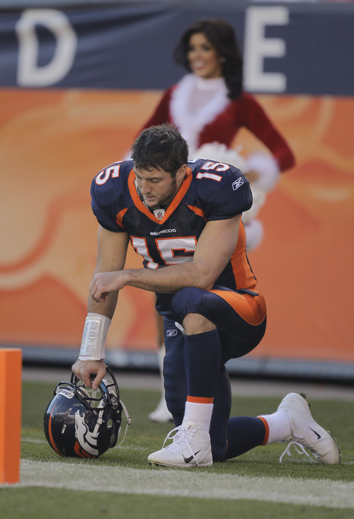Denver Broncos quarterback Tim Tebow (15) prays in the end zone before playing the New England Patriots in an NFL football game, Sunday, Dec. 18, 2011, in Denver. (AP Photo/Julie Jacobson)