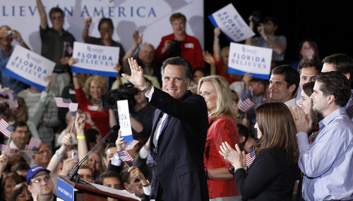 Republican presidential candidate, former Massachusetts Gov. Mitt Romney celebrates his Florida primary election win at the Tampa Convention Center in Tampa, Fla., Tuesday, Jan. 31, 2012. (AP Photo/Charles Dharapak)