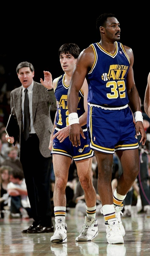 Tribune file photo  Karl Malone, right, and John Stockton played most of their Jazz career with Jerry Sloan, left, as their coach.