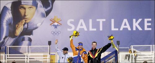 Steve Griffin | Tribune file photo Speedskaters Derek Parra, left, Jochem Uytdehaage and Jens Boden wave at a flower ceremony at the Utah Olympic Oval.
