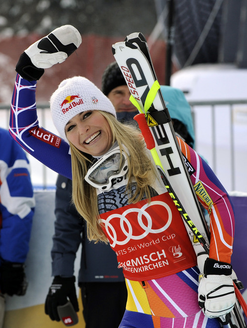 Lindsey Vonn, of the United States, waves as she celebrates after winning an alpine ski, women's World Cup downhill, in Garmisch-Partenkirchen, Germany, Saturday, Feb. 4, 2012. Vonn captured her 50th World Cup career victory by winning the downhill on the demanding Kandahar course on Saturday. The American is third on the all-time list, behind Annemarie Moser-Proell of Austria with 62 victories and Vreni Schneider of Switzerland with 55. Vonn now has 25 downhill wins, second behind Moser-Proell's 36. (AP Photo/Giovanni Auletta)