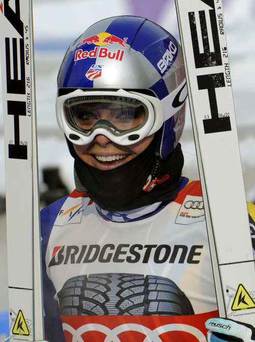 Lindsey Vonn, of the United States, smiles after winning an alpine ski, women's World Cup downhill, in Garmisch-Partenkirchen, Germany, Saturday, Feb. 4, 2012. Vonn captured her 50th World Cup career victory by winning the downhill on the demanding Kandahar course on Saturday. The American is third on the all-time list, behind Annemarie Moser-Proell of Austria with 62 victories and Vreni Schneider of Switzerland with 55. Vonn now has 25 downhill wins, second behind Moser-Proell's 36. (AP Photo/Giovanni Auletta)