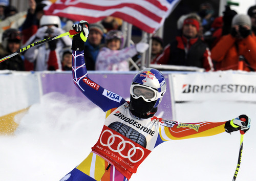 Lindsey Vonn, of the United States, celebrates after winning an alpine ski, women's World Cup downhill, in Garmisch-Partenkirchen, Germany, Saturday, Feb. 4, 2012. Vonn captured her 50th World Cup career victory by winning the downhill on the demanding Kandahar course on Saturday. The American is third on the all-time list, behind Annemarie Moser-Proell of Austria with 62 victories and Vreni Schneider of Switzerland with 55. Vonn now has 25 downhill wins, second behind Moser-Proell's 36. (AP Photo/Giovanni Auletta)
