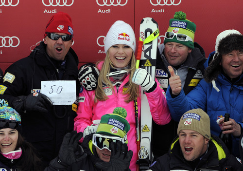 Lindsey Vonn, of the United States, celebrates with her team after winning an alpine ski, women's World Cup downhill, in Garmisch-Partenkirchen, Germany, Saturday, Feb. 4, 2012. Vonn captured her 50th World Cup career victory by winning the downhill on the demanding Kandahar course on Saturday. The American is third on the all-time list, behind Annemarie Moser-Proell of Austria with 62 victories and Vreni Schneider of Switzerland with 55. Vonn now has 25 downhill wins, second behind Moser-Proell's 36. (AP Photo/Giovanni Auletta)
