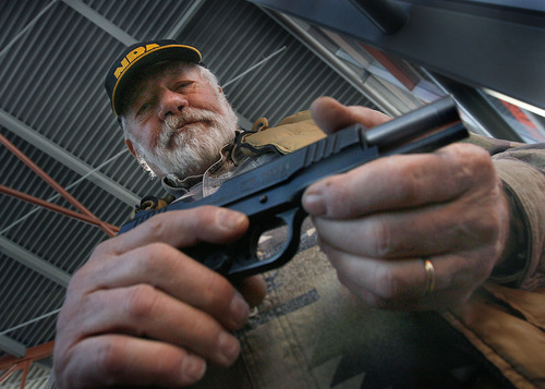 Scott Sommerdorf  l  The Salt Lake Tribune  Ralph Schamel, a lifetime member of the NRA, met people entering the Crossroads of the West Gun Show and offered them free admission in exchange for joining the NRA on Sunday. He also had a handful of guns for sale including this .45 caliber handgun. People attending the show gave their opinions on the impact the shooting in Tucson, Ariz., might have on gun owners.