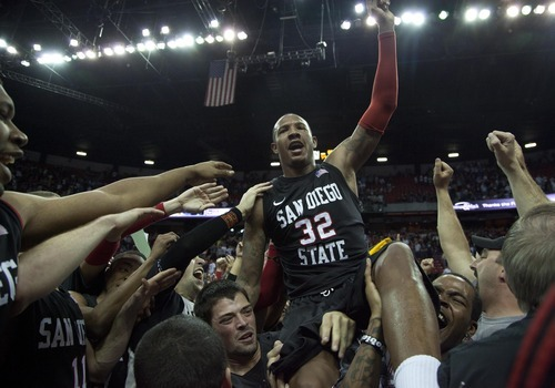 San Diego State's Billy White (32) celebrates with fans and teammates after defeating BYU 72-54 in an NCAA college basketball game in the championship game of the Mountain West Conference tournament, Saturday, March 12, 2011, in Las Vegas. (AP Photo/Julie Jacobson)
