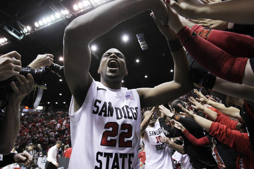 San Diego State's Chase Tapley (22) greets fans after beating No. 12 UNLV in an NCAA college basketball game, Saturday, Jan. 14, 2012, in San Diego. San Diego State won 69-67. (AP Photo/Gregory Bull)