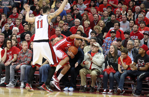 UNLV's Carlos Lopez forces New Mexico's Kendall Williams out of bounds during the first half of an NCAA college basketball game, Saturday, Jan. 21, 2012, in Las Vegas. (AP Photo/John Gurzinski)