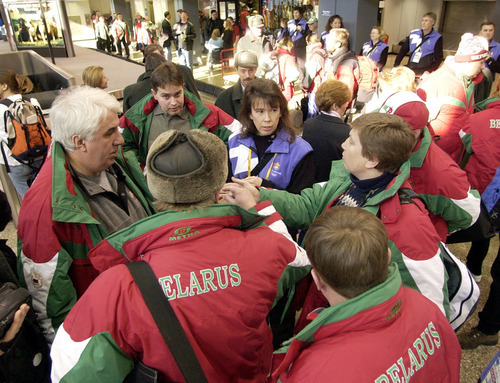 Tribune file photo Volunteer Arilyn Kusakabe helps reporters arriving from Belarus at the Salt Lake City International Airport at the start of the 2002 Salt Lake Olympics.