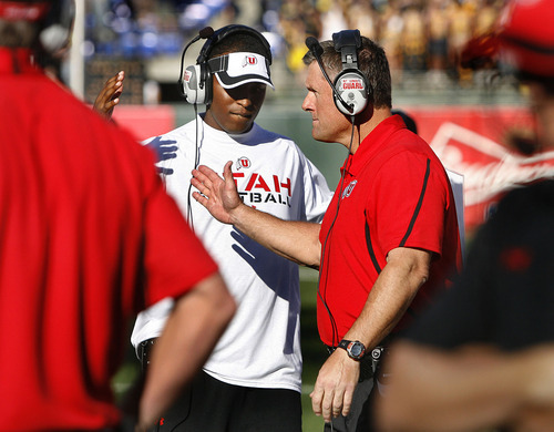 Scott Sommerdorf  |  The Salt Lake Tribune              Utah was expected to name former Utah QB Brian Johnson as their new offensive coordinator, Thursday, Feb. 2, 2012. In this file photo, Utah quarterbacks coach Brian Johnson slaps hands with head coach Kyle Whittingham just prior to kickoff against Cal at AT&T Park in San Francisco, Saturday, October 22, 2011.
