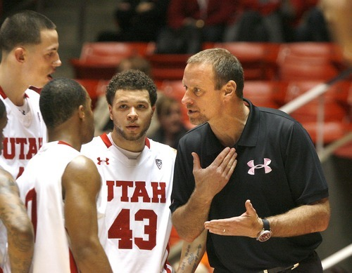 Paul Fraughton | The Salt Lake Tribune. Utah coach Larry Krystkowiak  talks to his players during a time out. Oregon defeated Utah 68 to 79 in The Huntsman Center.  Thursday, February 2, 2012