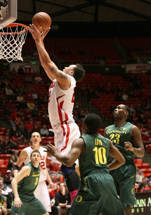 Paul Fraughton | The Salt Lake Tribune. Utah's Javon Dawson   goes to the hoop  in front of Oregon defenders Johnathan Loyd and Jeremy Jacob. Oregon defeated the University of Utah  Utes 79 to 68 in the Huntsman center.  Thursday, February 2, 2012