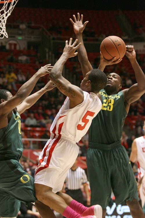 Paul Fraughton | The Salt Lake Tribune. Utah's Kareem Storey is fouled  as he goes to the basket. Oregon defeated the University of Utah  Utes 79 to 68 in the Huntsman center.  Thursday, February 2, 2012