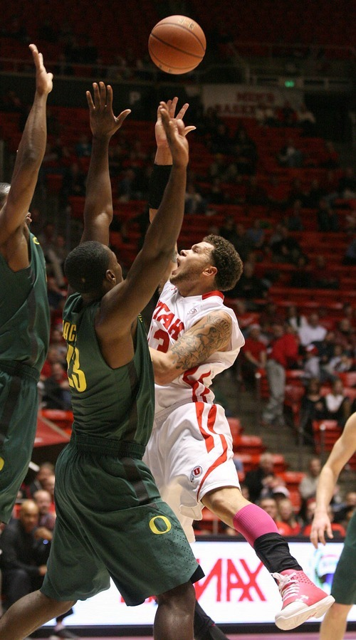 Paul Fraughton | The Salt Lake Tribune. Utah's Cedrick Martin  draws the foul as he goes to the basket. Oregon defeated the University of Utah  Utes 79 to 68 in the Huntsman center.  Thursday, February 2, 2012