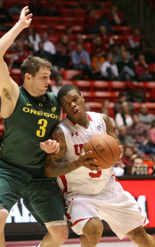 Paul Fraughton | The Salt Lake Tribune. Utah's Kareem Storey leans on Oregon's Garrett Sim. Oregon defeated the University of Utah  Utes 79 to 68 in the Huntsman center.  Thursday, February 2, 2012