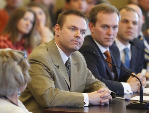 Trent Nelson  |  The Salt Lake Tribune James Humphries, left, of the Utah Log Cabin Republicans, speaks in favor of legislation to ban discrimination against gay and transgender Utahns. SB51 sponsoring Sen. Ben McAdams, D-Salt Lake City, looks on. The measure was tabled on a 4-1 vote.