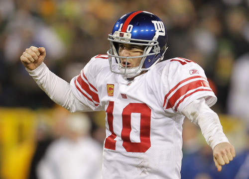 AP file photo | Darron Cummings   New York Giants quarterback Eli Manning reacts during the second half of an NFL divisional playoff football game against the Green Bay Packers Sunday, Jan. 15, 2012, in Green Bay, Wis.  The Giants won 37-20.