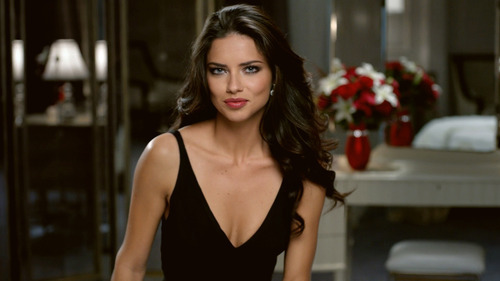 This advertisement provided by Teleflora, shows a scene from the ad with super-model Adriana Lima set to launch during Super Bowl XLVI, which will air Sunday, Feb. 5, 2012. Teleflora's 30-second spot will debut during the game's second quarter. About 20 of the roughly 36 Super Bowl advertisers put their TV commercials online in the days leading up to Sunday's broadcast. That's a big break with tradition and up from last year when only a handful of companies released their ads before the game. Millions have already viewed Lima's pre-released Teleflora ad. (AP Photo/Telaflora)